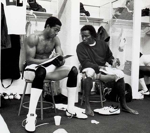 L.A. Raiders cornerbacks Mike Haynes and Lester Hayes talking before a game against the Atlanta Falcons.