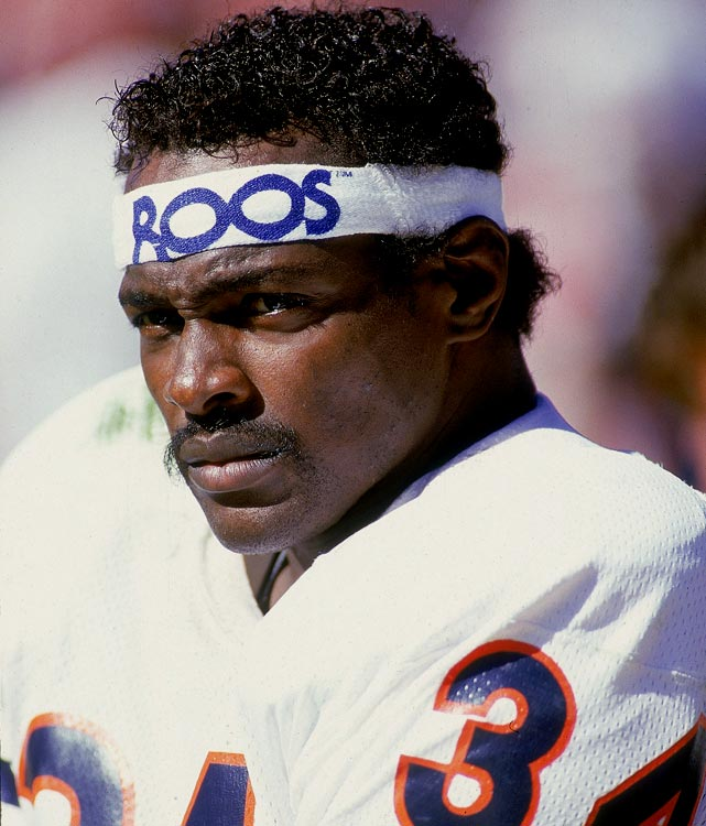 """Sweetness,"" as the late Walter Payton will forever be remembered, combined finesse with power and raw, unbridled violence when he carried the ball. He crushed blitzing linebackers and made defensive backs grasp for air in the open field, playing with a style more symphonic than multi-dimensional. In 1985, the Hall of Fame back rushed for 1,551 yards on 324 carries."