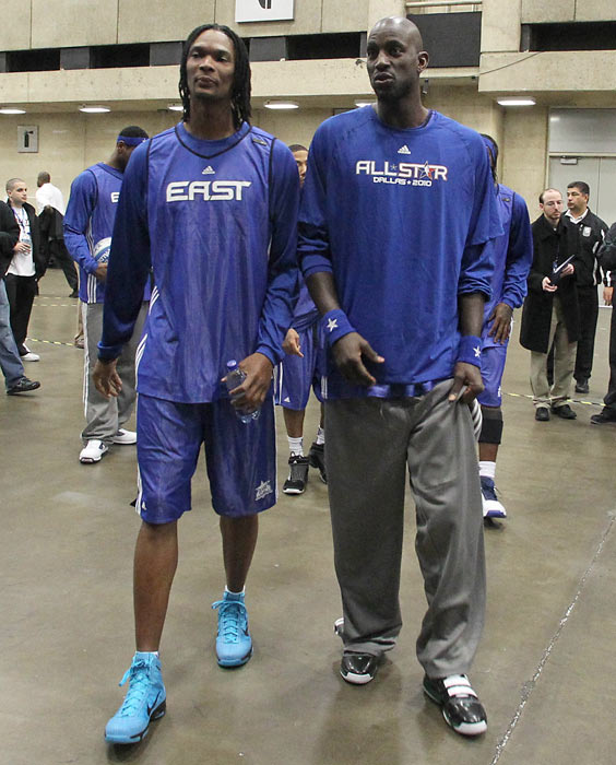 Bosh  and Kevin Garnett walk to the East All-Stars Practice on center court during All-Star Weekend.
