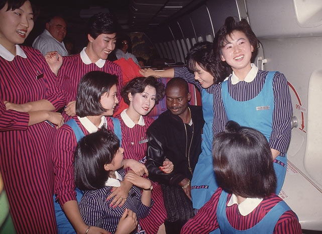Canadian sprinter Ben Johnson is a hit with the flight attendants on his way home from Seoul after the 1988 Summer Olympics. Johnson was eventually stripped of his gold medal for illegal drug use.