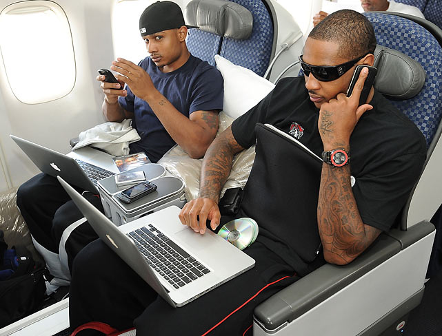 Carmelo Anthony and Dontaye Draper prepare for a flight to Miami to take on the Heat.