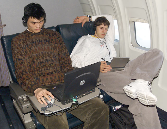 Houston's  Yao Ming and Bostjan Nachbar relax on the team airplane.