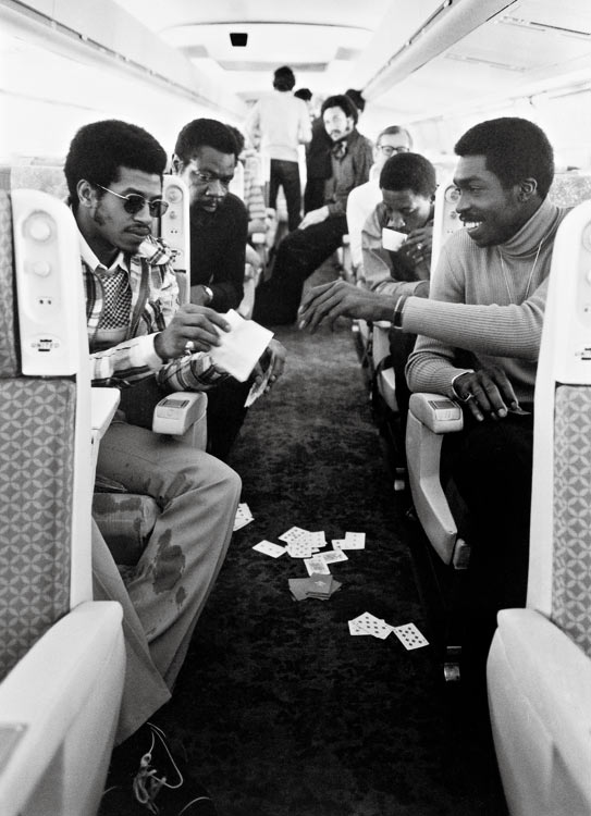 Dean Meminger (left) and Earl Monroe of the Knicks play cards with teammates after beating the Lakers for the NBA title.