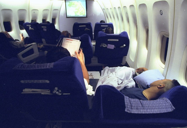 Tiger Woods catches some sleep on a flight from Los Angeles to Thailand.