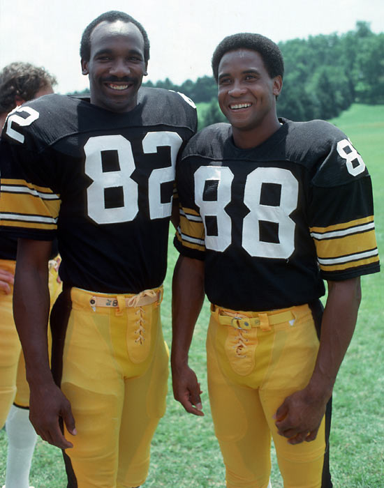 Wide receivers John Stallworth (82) and Lynn Swann pose during training camp at St. Vincent College in Latrobe, Penn.