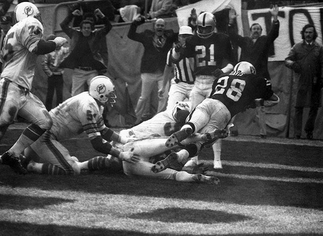With only 24 seconds left in a 1974 AFC divisional playoff game, Raiders running back Clarence Davis somehow managed to catch the game-winning touchdown amid a sea of Dolphin defenders' hands.  It's the sole iconic NFL play of which the Raiders were the beneficiary.