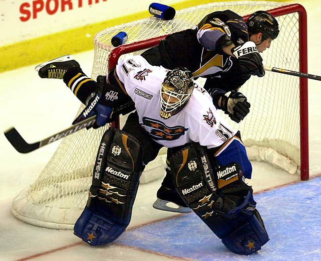 He's the only player to capture an individual award while wearing this number (Vezina Trophy, 2000).
