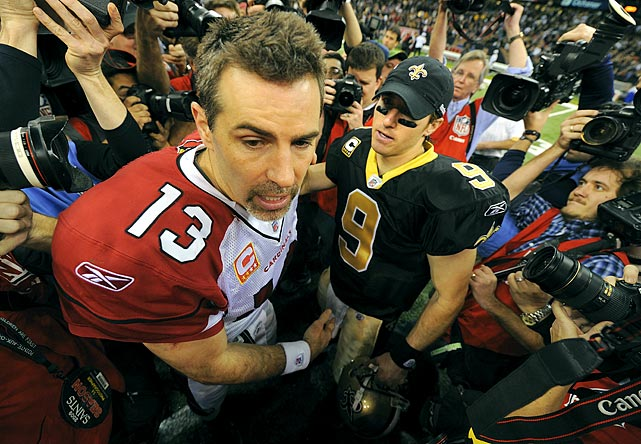 Cardinals quarterback Kurt Warner and Brees meet at midfield after the Saints' 45-14 win in a divisional home playoff game last January.