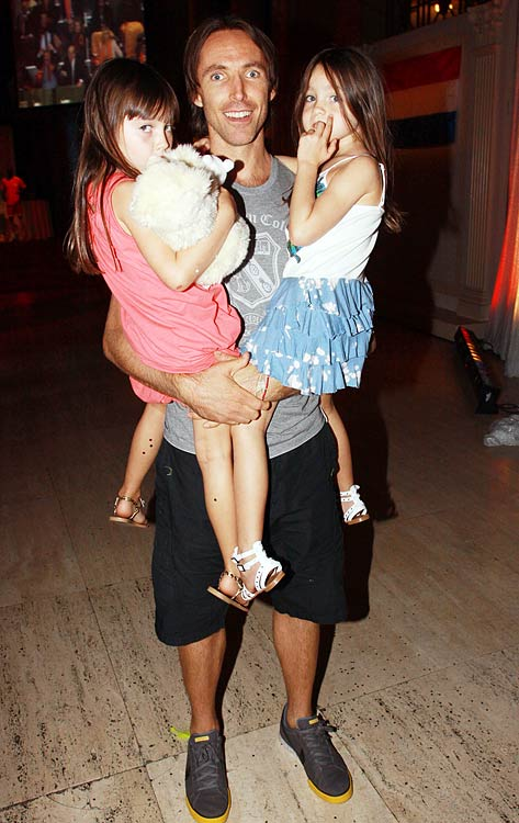 Holding his twin daughters Lola and Bella, Nash takes a picture after the World Cup Final in 2010.  The girls were both born on Oct. 14, 2004.