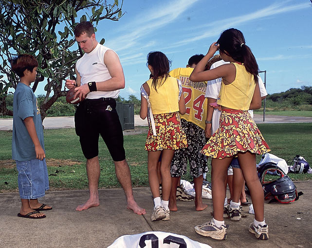Always a fan favorite, Brees signs autographs before the Hula Bowl in Hawaii in 2001.  He'd throw for 119 yards and a touchdown in the game.