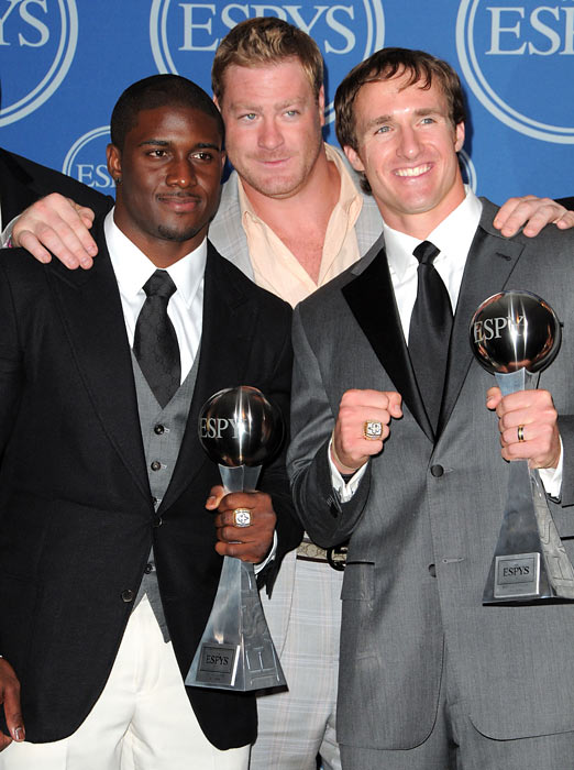 Alongside teammates Reggie Bush and Jeremy Shockey, Brees accepts the ESPY for Best Team during the 2010 awards show.  It was one of a number of awards that Brees captured, as he also was presented with trophies for Best NFL Player, Best Championship Performance and Best Male Athlete.