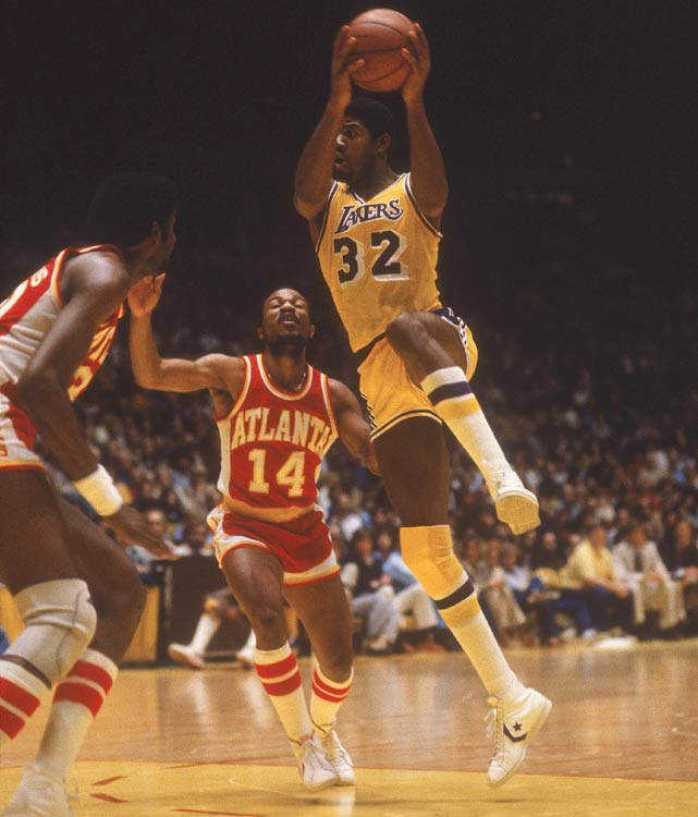 Bird won Rookie of the Year, but Magic took the top prize of all in 1980 -- the NBA championship. As a rookie, Magic started at center in place of the injured Kareem-Abdul Jabbar in Game 6 of the NBA Finals and poured in 42 points and 15 rebounds against the Sixers. The Lakers won the title and Magic was named Finals MVP. Prior to that, Magic averaged 18 points, 7.7 rebounds and 7.3 assists per game during the regular season.