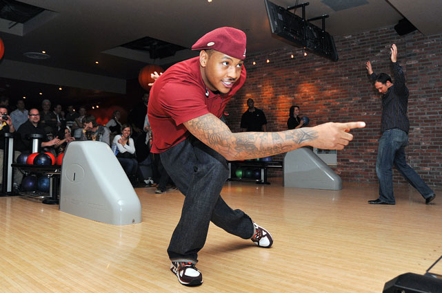 Carmelo shows of his bowling skills at a charity event in Colorado.