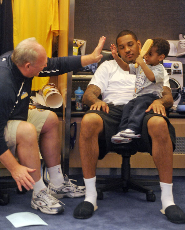 'Melo and mini-'Melo (his son Kiyan) spend some quality bonding time with coach George Karl in the Nuggets' locker room.