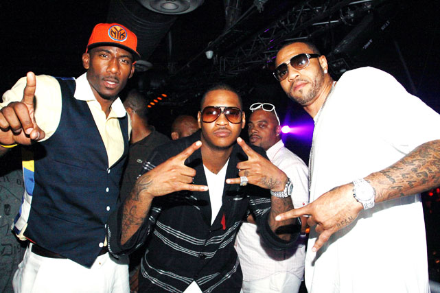 """Pre-wedding festivities at Amnesia in New York City with Amar'e and Kenyon Martin. Pretty sure Amar'e is flashing a """"No. 1"""" sign, but it's unclear what Carmelo and Martin are doing."""