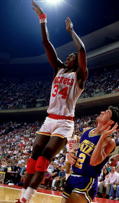 Selected first overall by the Rockets in '84, the 7-foot Nigerian made his mark on the league with rookie averages of 20.6 points, 11.9 rebounds and 2.7 blocks alongside Ralph Sampson in Houston. Olajuwon helped the Rockets improve from a 29--53 record the year before his arrival to 48-34 in his first season, while finishing second in the Rookie of the Year voting, behind Michael Jordan. Among the Hall of Famer's many career highlights: two NBA championships, an NBA MVP award, two Defensive Player of the Year honors, an Olympic gold medal and an all-time league record in career blocks (3,830).