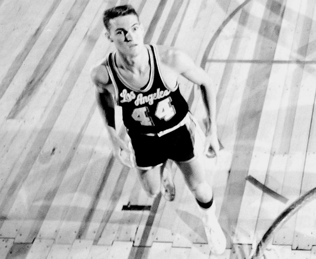 """The 6-foot-2 guard out of West Virginia was selected by the Minneapolis Lakers --- who relocated to L.A. shortly after drafting him -- with the second overall pick. """"Mr. Clutch"""" quickly established himself as one of the Lakers' primary options on offense, averaging 17.6 points, 7.7 rebounds and 4.2 assists his first year. The combo guard was named to first of 14 All-Star Games, in which he had nine points and four assists in the West's 153-131 win. West went on to earn an All-Star Game MVP award (1972), 12 All-NBA Team selections, an NBA championship (`72), a Finals MVP ('69) and a spot among the NBA's 50th Anniversary All-Time Team as a player."""