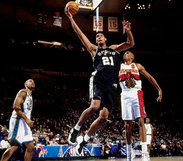Coming off a 20-62 season, the Spurs selected Duncan with the top overall pick in 1997. Playing alongside Hall of Famer David Robinson, Duncan fit in instantly in San Antonio. In just his second road game, in Chicago against rebounding and defensive great Dennis Rodman, Duncan grabbed 22 boards. As the last rookie to be voted an All-Star by coaches, Duncan has been voted an All-Star 13 times (including this year) and was named the Game's MVP in 2000.