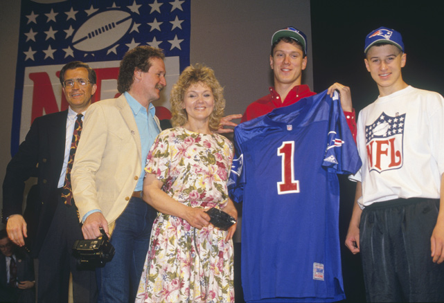 The Washington State QB, posing here with his family, went to the Patriots with the No. 1 overall pick. Bledsoe compiled a 63-60 record as a starter for New England and led the team to the 1997 Super Bowl. He lost his starting job to Tom Brady in 2001 but went on to play three seasons with the Bills and two with the Cowboys.