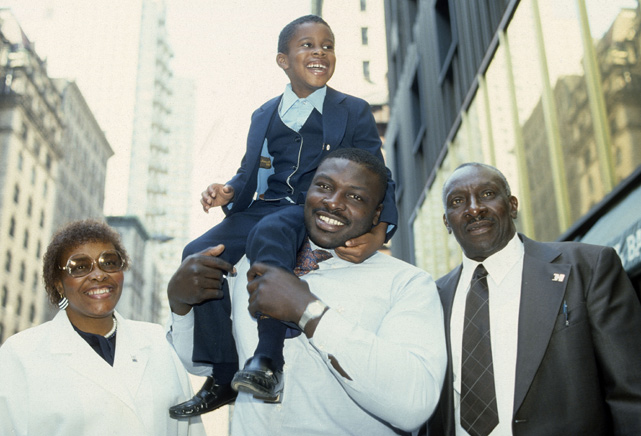 The Hall of Famer poses for a photo with his family after the Buffalo Bills drafted him with the No. 1 overall pick. He compiled 200 sacks during his career, an NFL record, and was the league's defensive player of the year twice.