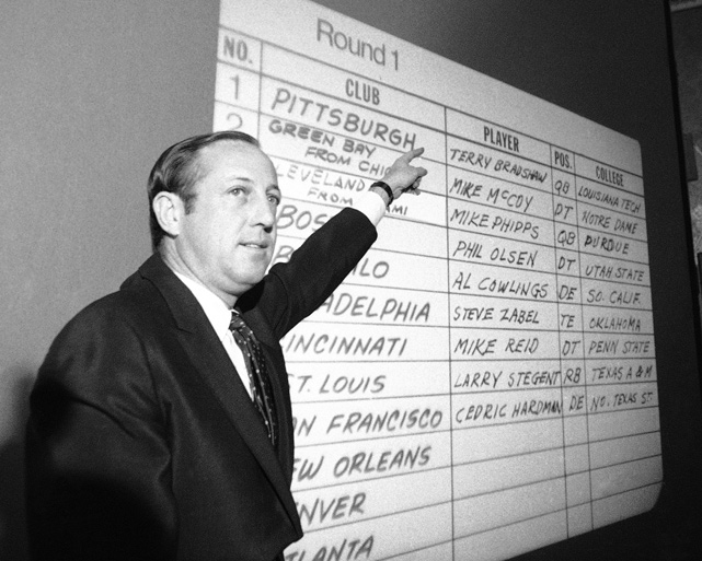 The NFL commissioner points to Terry Bradshaw's name at the top of the NFL draft board. Rozelle was in charge of the NFL from 1960 until 1989 and helped it grow into the most popular professional sports league in America.