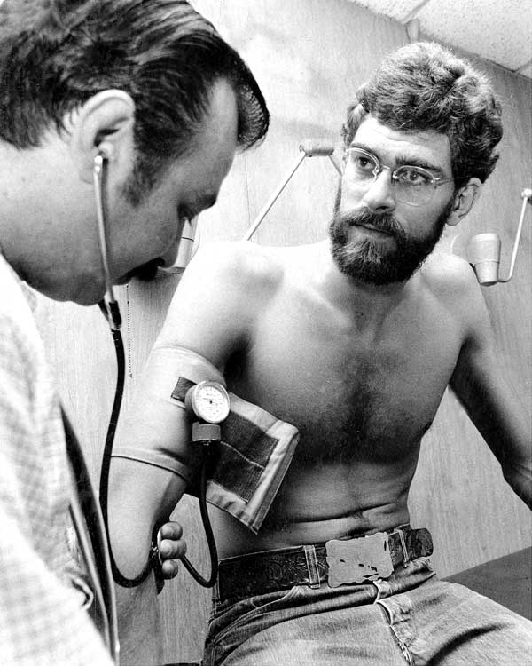 Madison Square Garden physician, Dr. G. Viti, takes Jackson's blood pressure as the Knicks reported for preseason physicals.