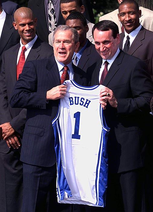 Then-President George W. Bush receives a jersey from Krzyzewski after Duke's 2001 national championship season. Krzyzewski has led Duke to four NCAA titles.