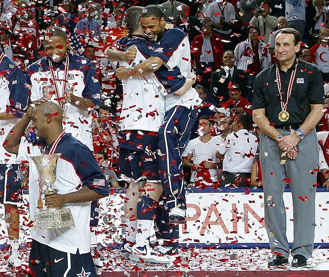 Krzyzewski looks on as Chauncey Billups, Kevin Love and Eric Gordon celebrate winning the 2010 World Basketball Championship. Krzyzewski has signed on to coach the 2012 U.S. Olympic team in London.