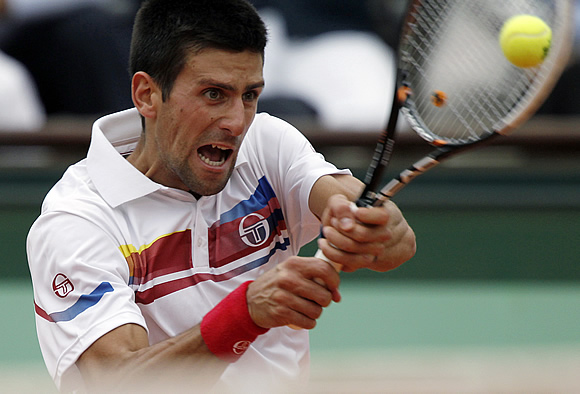 Judging from the look on Novak Djokovic's face, hitting a backhand isn't as easy as it seems