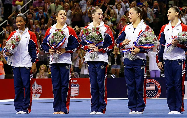 Teammates (left to right) Gabby Douglas, Aly Raisman, McKayla Maroney, Jordyn Wieber and Kyla Ross celebrate on the podium after the announcement that they would be the five gymnasts representing Team USA in London.