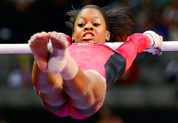 Douglas competing on the uneven bars during the US Olympic team trials. After four events, Douglas finished first in points, nabbing the only guaranteed spot on the Olympic team.