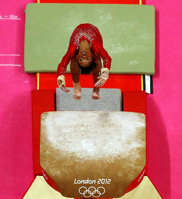 Douglas executes a nearly flawless Amanar vault during the team all-around finals on day four of the London Olympics.
