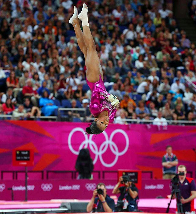 Gabby Douglas completes an Amanar vault during the all-around individual final competition for the 2012 Summer Olympics.
