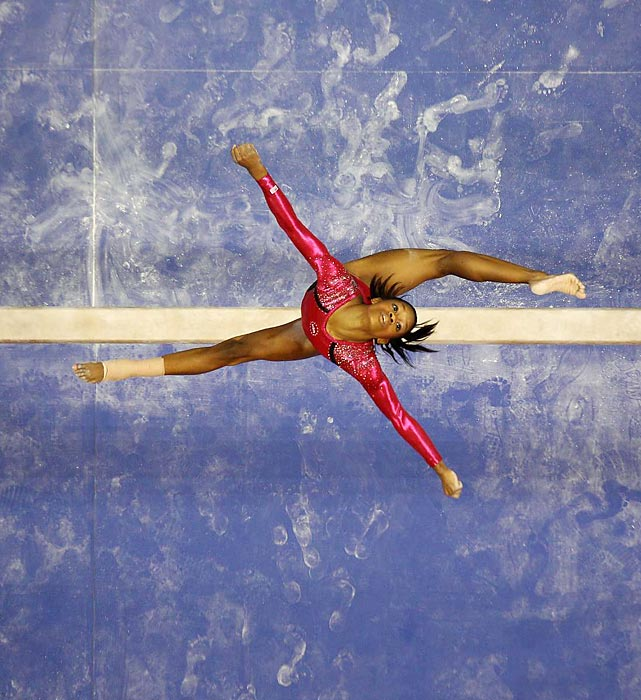 The Flying Squirrel soars above the balance beam during Day 1 of the USA Olympic Trials. Although Douglas ended Day 1 behind teammate Jordyn Wieber, she rallied on the second day to finish first in the trials.