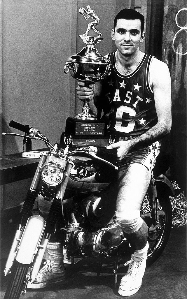 Jerry Lucas shows off his MVP trophy. They didn't let him ride the motorcycle during the game.