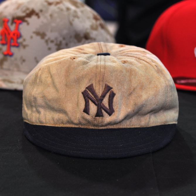 """""""This cap has a pretty cool story to it, and it's one of those that you don't know what you have until you get a chance to look at it a little bit more,"""" Strohl said.                                                      Before the Yankees were the Yankees, they were called the Highlanders. But even then there was a New York-Boston rivalry. And that's where the historical significance of this hat comes in.                                                      This cap was donated to Cooperstown in 1990 by Paul Otis. Otis played four games for the Highlanders in 1912. When researchers began examining the cap, they found Otis' name written inside it. But under the leather headband they found another name: Cozy Dolan. Dolan played third base for the Highlanders in 1912 until he was sent down to the minors in June of that season. That means he was wearing this hat when he took the field on opening day 1912 when the Highlanders took on the Red Sox in Boston. It was the first game ever played at Fenway Park.                                                      This cap is also an important link in the evolution of the baseball cap. It has six panel and stitching along the brim, both of which can still be found in hats today."""