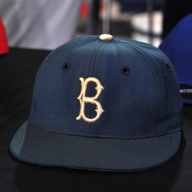 This cap was worn by Jackie Robinson in the 1955 World Series. The Brooklyn Dodgers defeated the Yankees to win its first world championship.