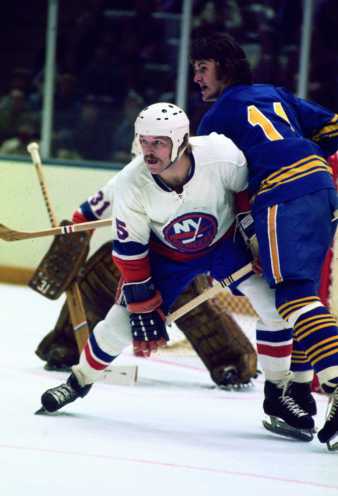 As captain of the Islanders, defenseman Dennis Potvin led his team to won four consecutive Stanley Cups. In those four playoff runs, he never won a Conn Smythe Trophy as playoff MVP but he racked up 37 goals and 85 points.Potvin was one of the great offensive defensmen in NHL history. He was the first defenseman to score 1,000 career points, finishing his career in 1988 with 366 goals, 850 assists and 1,216 points.