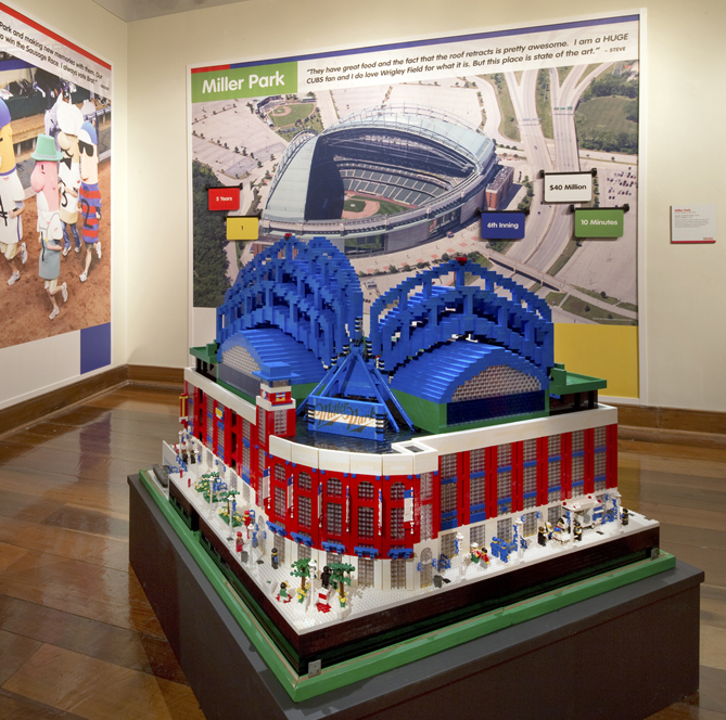 """The other large ballpark on display is Miller Park. It's made out of 35,000 LEGO bricks and took its builder, Tim Kaebisch, nine years (!!) to complete. It's so detailed that it even features a retractable roof.""""[Tim] loved LEGO, but he was starting to get bored with it and wanted to add movement,"""" Jewell says. """"So he figured out a way to add movement. Three times a day, when we open and close that roof, the crowds are just gathered around and fascinated by it."""""""