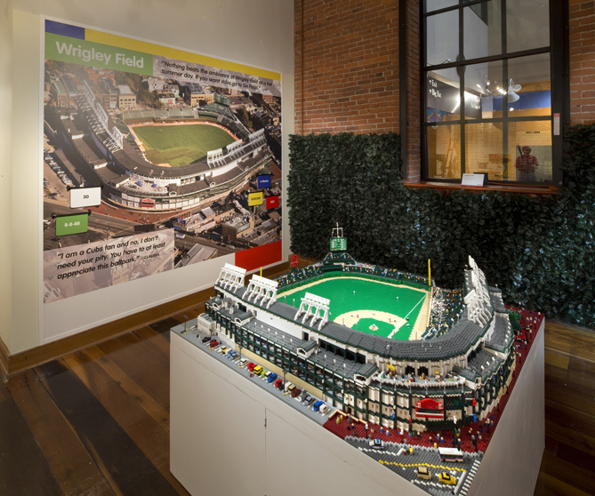 """There are five stadiums made of LEGOs on display: Wrigley Field, Miller Park, PNC Park, Marlins Park and Yankee Stadium. Wrigley is one of the largest, made up of 57,960 LEGO bricks. It took artist Sean Kenney 640 hours to build it!""""Sean built them in his studio in New York, and he would send us pictures periodically,"""" Jewell says. """"And what happens is he ships them here. Wrigley Field [was so big that it] was broken down into four or five big sections, maybe more. Then he came to the museum to reassemble it."""""""