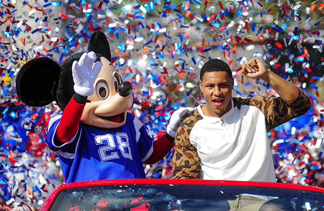 """Since the late 1980s, it's been a tradition for the Super Bowl MVP to celebrate with Mickey, Donald, and the rest. Seattle Seahawks linebacker Malcolm Smith talked about his big trip after the team's Super Bowl XLVIII win.                                                      """"I remember Terrell Davis won the Super Bowl with the Broncos [when I was eight] and said, 'I'm going to Disney World.' But even though I've always played football, I never thought that would be me. Especially as a defensive player. I wasn't thinking about it until the game was over. The Disney folks tell you to be enthusiastic for the cameras, but I was already excited. You say, 'I'm going to Disney World,' and 'I'm going to Disneyland,' like, 20 times.                           I left for Disney World at 6 a.m. on a private plane. I took my girlfriend. I ate a steak and candy and took a nap. I even had a waiter. Flying will never be the same.                                                      I did the parade as soon as I got there. There were thousands of people, and some wore Seahawks' jerseys, even mine, which was rare. I did interviews. I signed footballs for 45 minutes.                           A couple days later, I was watching TV, and I heard, 'When You Wish Upon a Star,' and I knew it was the commercial. Then I heard myself. What a surreal experience that was."""""""