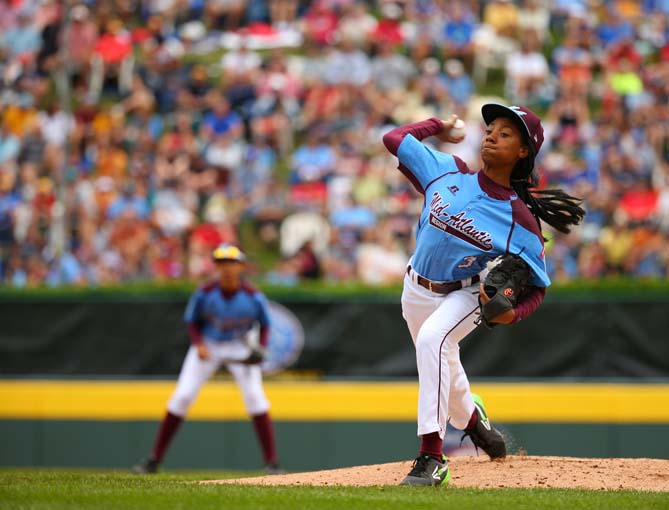 Mo'ne Davis, the star pitcher and infielder of the Taney Little League team from Philadelphia, will be starting the eighth grade in a week weeks and carries a hot-pink backpack everywhere she goes. She also happens to throw a 70-mph fastball and the most-talked-about curve east of Clayton Kershaw.