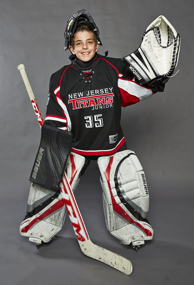 "The starting goalie on the New Jersey Titans Squirt team, Luke has worn hearing aids since he was six years old, and in spite of this obstacle he is an integral part of the team. Luke moved into the net a year ago, and he has excelled ever since. ""Before I was goalie, I was not able to hear the whistle, so I would keep playing even after play had stopped,"" he says. ""As goalie I just need to stop the puck!"" Luke, 10, participates in baseball and basketball, too; on the court he watches the clock closely to know when the buzzer will go off. Luke is also on the American Hearing Impaired Hockey Association freshman team, and he raises money and awareness for the AHIHA by posting flyers in hockey rinks and selling raffle tickets for their annual auction. ""I love to win,"" he says, ""but most importantly I'm there to demonstrate that it is okay to be different!"""