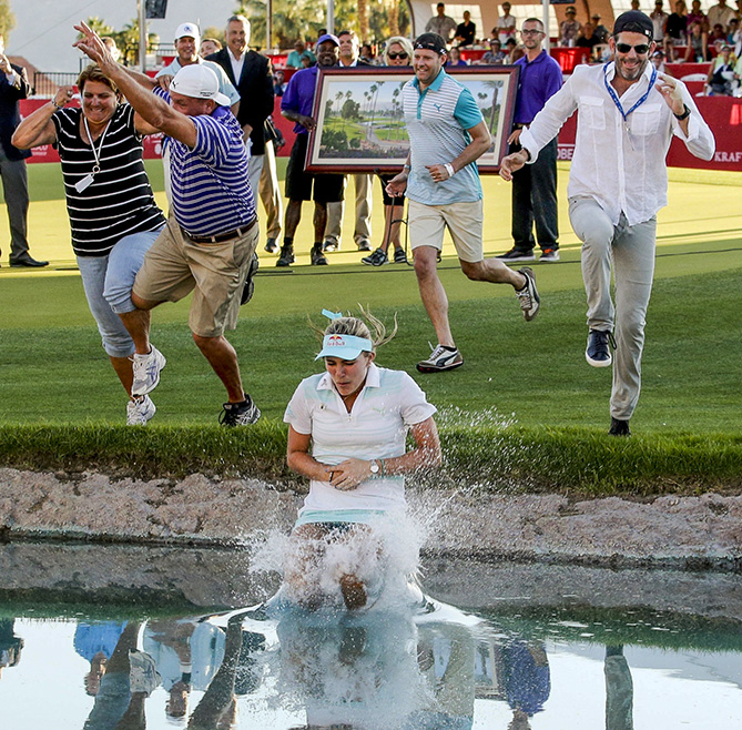 """After winning the 2014 Kraft Nabisco Championship, 19-year-old Lexi Thompson took part in the ceremonial dunking in Poppie's Pond, which surrounds the 18th green at Mission Hills Country Club in Rancho Mirage, California.                                                      """"Just being able to jump in with my family and caddie there beside me was a dream that I had for so long that finally came true. I had so many people jump in with me — they just kept coming! I remember the leap into the pond more than anything about that day. I do replay some of the shots from the final round in my head, but jumping into Poppie's Pond stands out. I've re-watched that video of myself taking the leap many times. To be able to wear the white robe afterward was an awesome feeling because you know what you've accomplished."""""""
