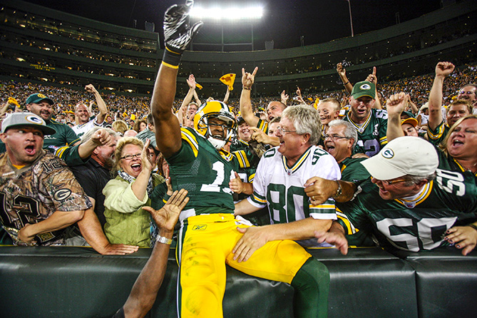 """During his first NFL game, in 2011, Randall Cobb caught a touchdown pass and scored on a record-tying, 108-yard kick return. The pressure was on to perfect the Lambeau Field tradition of celebrating with fans.                                                      """"Immediately after I dove into the end zone, I went into a panic. I didn't know what I was supposed to do. But then I just remembered, 'Oh yeah, Lambeau Leap.' So I jogged over there and jumped up. My teammates made fun of me because I didn't realize the wall was so high, and I hit the side of the wall. Luckily the fans grabbed me and pulled me up. The second score, when I got to the end zone, I just remember Jarrett Bush tackling me and me falling on my back, and then I had eight or nine guys jump on top of me. Finally, when they got off of me, they pointed at the wall, and I took off. This time, I used my hand as a prop to help push me up."""""""