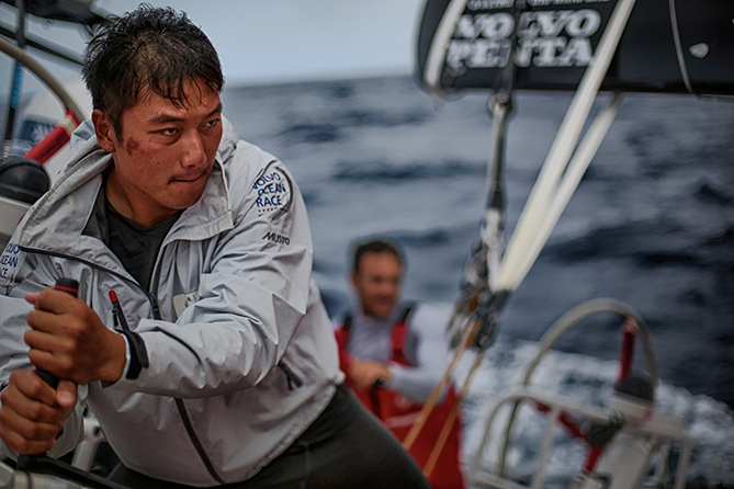 October 11, 2014. Leg 1, Jin Hao Chen,aka Horace, trims the sails onboard Dongfeng Race Team.