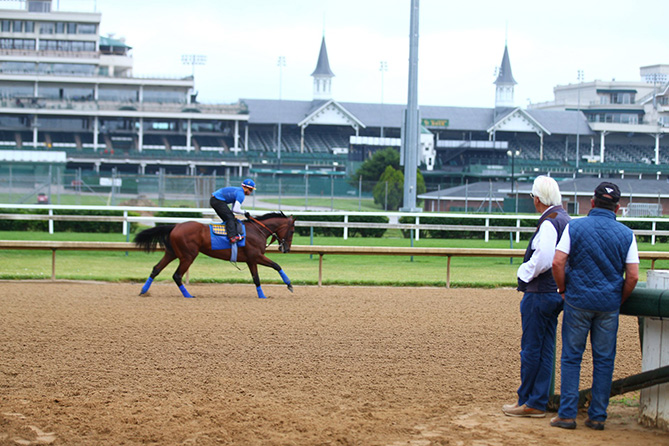 Baffert watches American Pharoah gallop at Churchill.