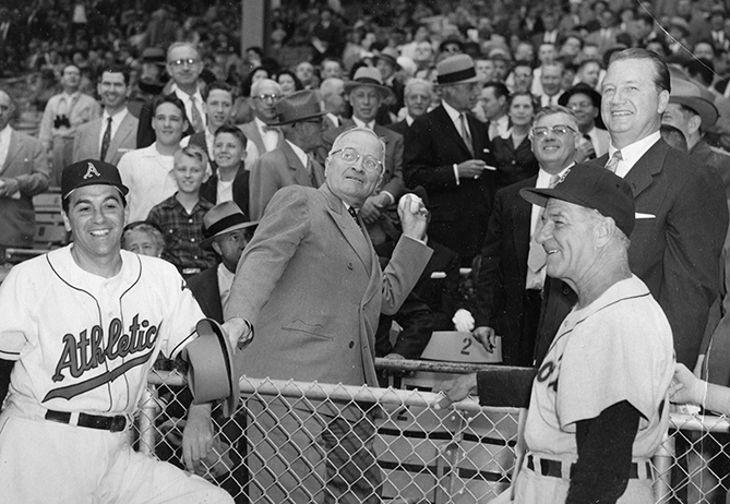"President Truman, a southpaw, threw out eight first pitches — nine if you count the one he threw right-handed — and attended a total 16 games, all in Washington. He was the first president to throw a left-handed first pitch, and the first to attend a night game on August 17, 1948. ""May the sun never set on American baseball,"" Truman once said."