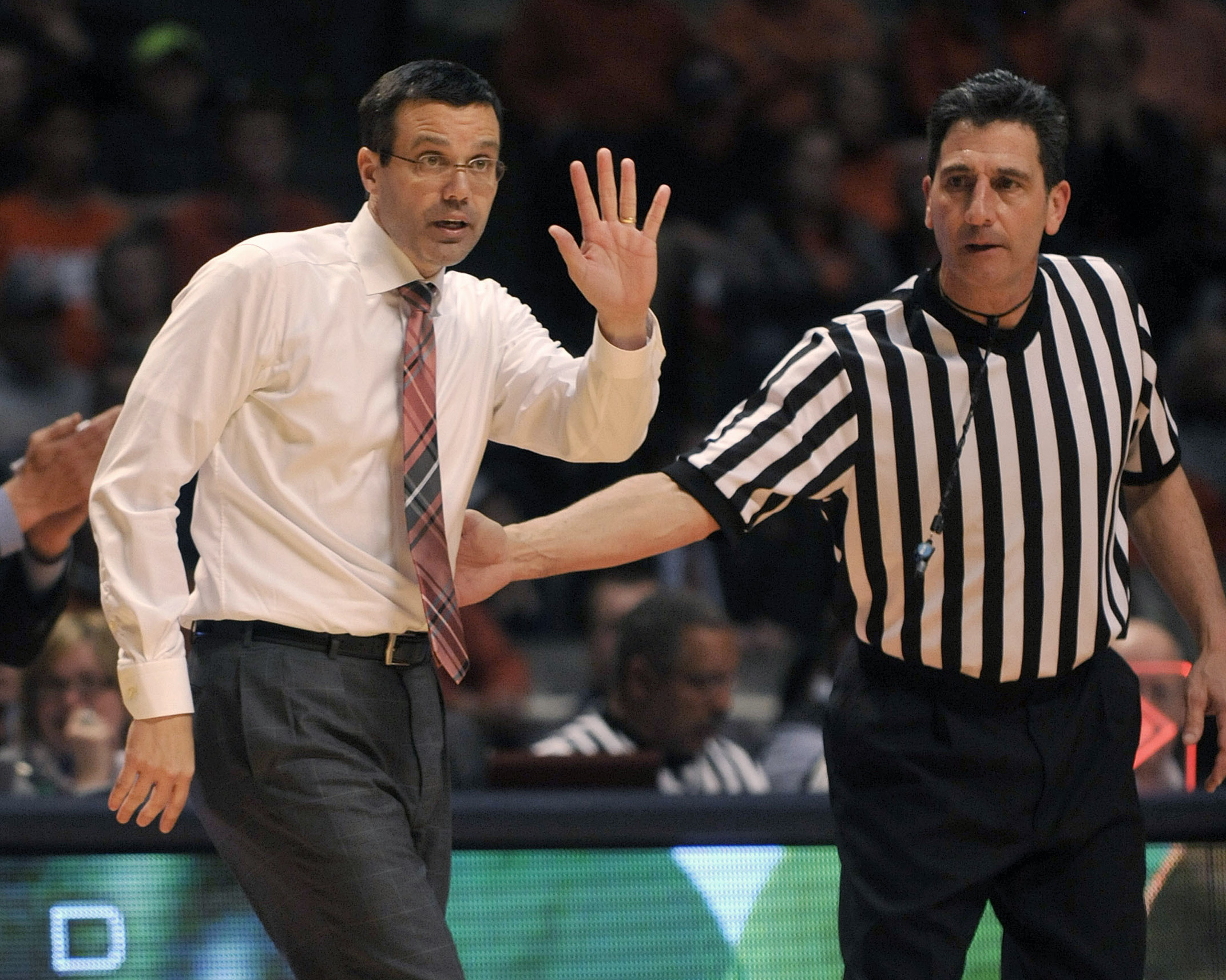 FILE - In this March 4, 2015 file photo, Nebraska coach Tim Miles coaches from the sidelines during an NCAA college basketball game against Illinois in Champaign, Ill. After the unexpected losses of two players and an assistant coach and the expected depa