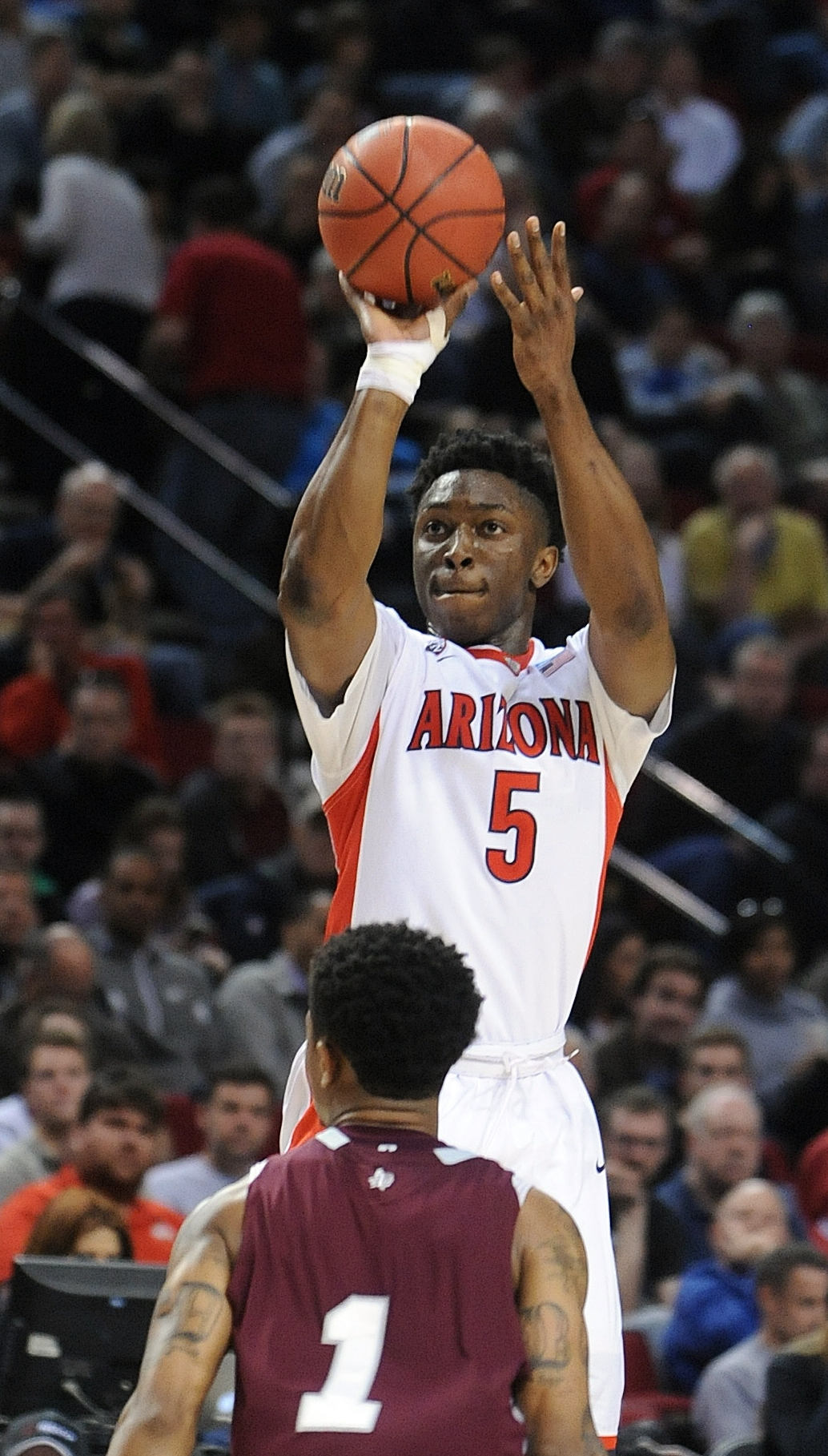 Arizona forward Stanley Johnson shoots over Texas Southern guard Deverell Biggs during the second half of an NCAA college basketball second round game in Portland, Ore., Thursday, March 19, 2015.  Johnson scored 22 points as Arizona won 93-72. (AP Photo/G